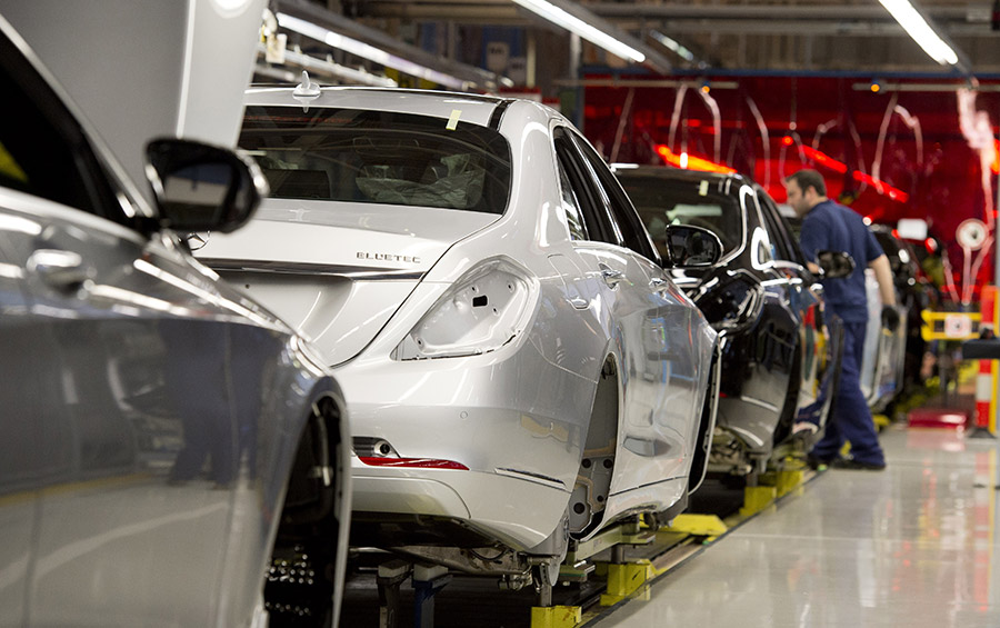 Mercedes-Benz S-Class cars are lined up on the assembly line in the Daimler factory. (THOMAS KIENZLE/AFP/Getty Images)