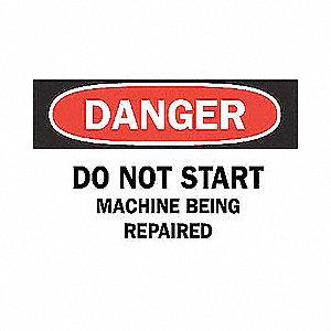 SIGN DO NOT START MACHINE BEING...